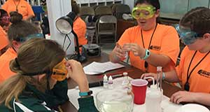Girls engaged in Math and Science explore at the Dauphin Island Sea Lab